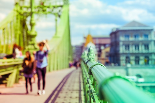 Liberty bridge in Budapest, Hungary with people walking on it. D
